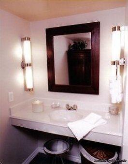 Vineyard Court Designer Suites Hotel College | Best Rates Guarantee | Book  Now